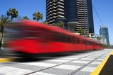 Beautiful red trolley moving fast through downtown