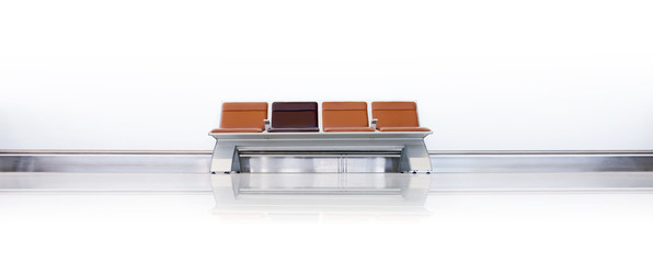 Clean, wide, shot of airport seats