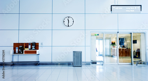 canvas print picture Airport Interior with clock, phones and exit