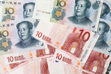 Mixture of Chinese and Euro currency notes.. poster
