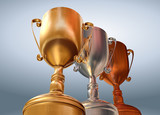 Rendered three cups (gold, silver, bronze) on blue background