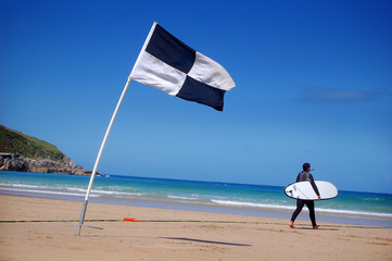 A surfer and surf area flag.
