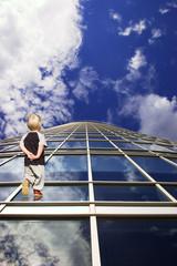Child and his path to future. Perspective of skyscraper windows