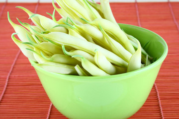 String yellow beans on a white background