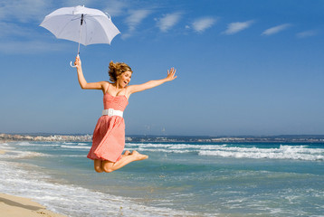 young happy woman jumping on vacation