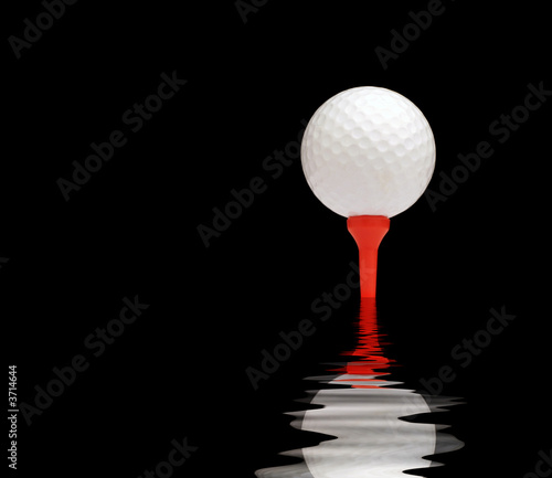 White golf ball on red tee. Black background with water effect.