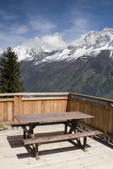 View of Aiguille Du Midi from picnic seats in Parc de Merlet