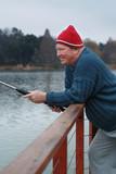 Seniors retirement image of man fishing from jetty poster
