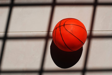 basket ball and shadow on the floor