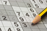 Incomplete Sudoku puzzle with a pencil.. poster