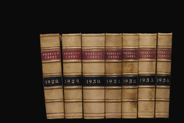 Spines of law reports against a black background