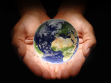 Hands holding the earth on a black background - 3723412