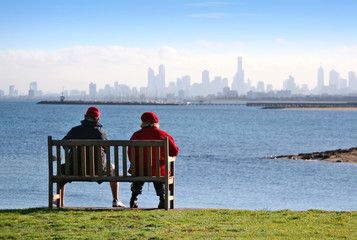 A man and woman on a clifftop bench