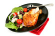 Meal of roast chicken and greek salad