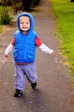 Little boy running down a quiet path poster