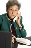 senior citizen office executive talking on phone at desk   poster