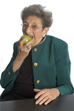 attractive senior citizen eating an apple poster