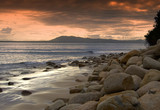 a nice landscape of a gentle beach at sunset poster