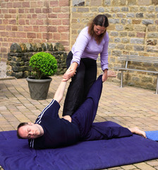 Half locust pose as part of a Thai body massage.