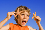 happy excited child showing starfish poster