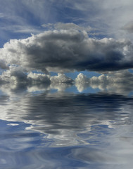 clouds in the sky with a digital reflection on the water