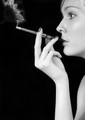 Smoking beauty girl over black background. Black&white
