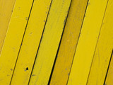 Diagonal wooden planks, painted in different shades of yellow poster