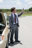 A businessman whose car has broken down poster
