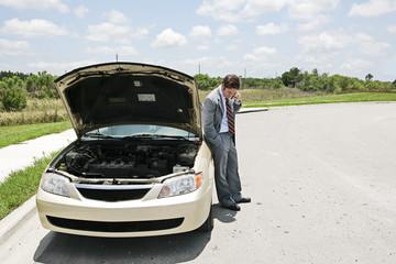 A businessman whose car has broken down