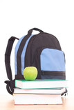 blue backpack and stack of books isolated on white poster