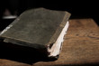 Leather covered old bible lying on a wooden table