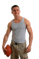 A muscular young man holding a football