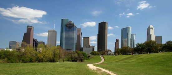 Path in park leading to city skyline