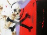 Skull graffiti with crossing bones, danger or warning sign poster