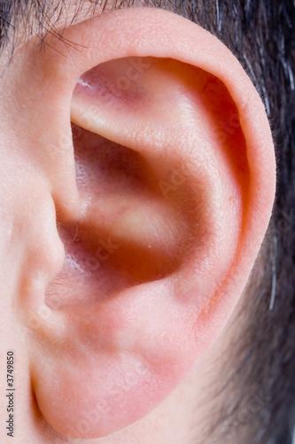 closeup of a man ear in color