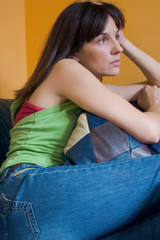 woman on sofa in apartment, casual wear