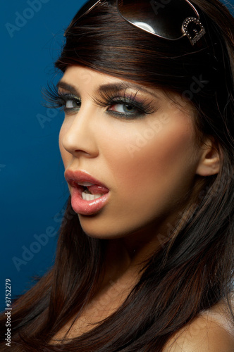Portrait of Young woman isolated on blue background