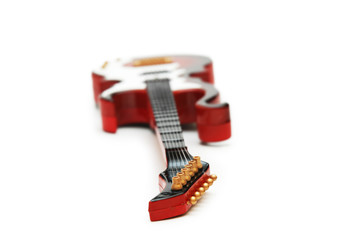 Rock guitar with shallow DOF isolated on white