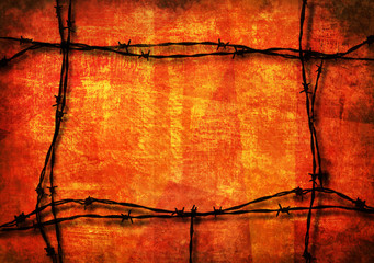 Red grunge background framed with barbed wire