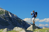 Backpacker standing on a rock in national park Pirin, Bulgaria poster