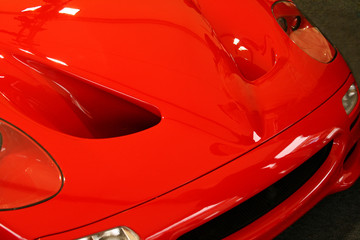 red supercar hood