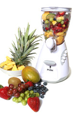 Colorful fruit and ice in a blender