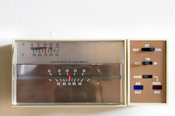 An indoor thermostat control for heating and air conditioning.