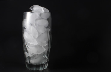 Ice cubes in a clear water glass.