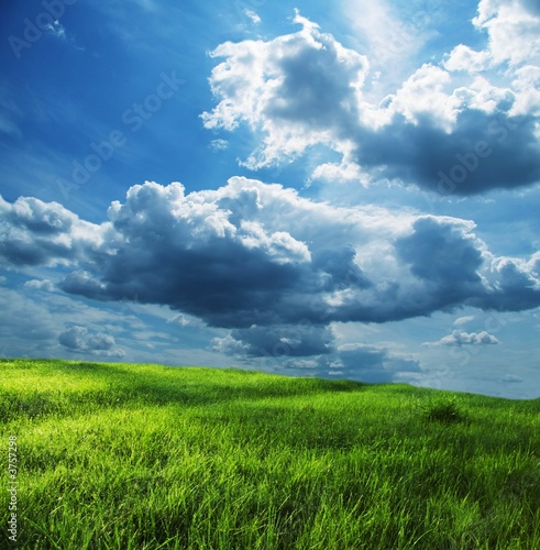 Field and storm clouds