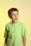 A child lets out an angry scream or shout poster