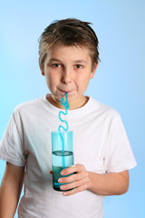 Child sips water from a glass