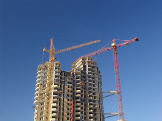 Construction works on a highrise building with cranes