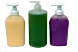 Bottles/containers of hand wash/handwash. Liquid soap. Hygiene poster