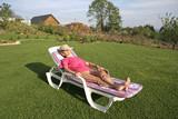 woman pensioner relaxing in her garden poster